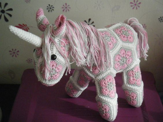 Crochet unicorn made out of African Flowers This one is sold on etsy, but it's a good idea.