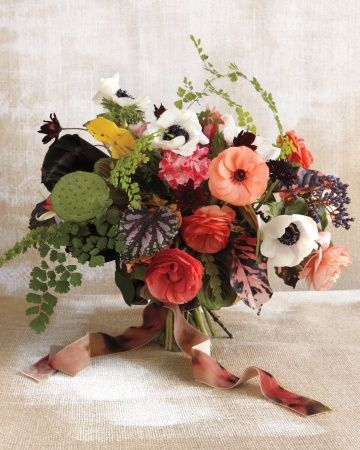 Ranunculus, anemones, chocolate cosmos, lotus pods, and viburnum berries