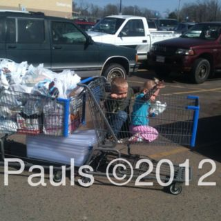 Shopping cart train. I use this all the time. Simple solution to needing two baskets. Line up like you see here, the one on the right close the baby seat and use the seat belt to clip to the full cart on left. Then pull your train! Works great!!