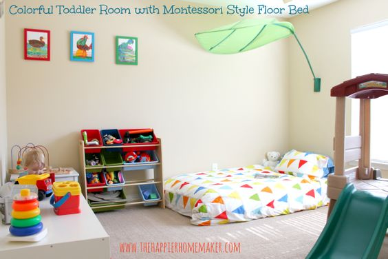 Montessori-inspired bedroom - floor bed, low shelves (Think IKEA expedit), and independence-encouraging activity spaces.: