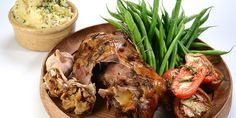 Nigel Haworth's luxurious confit lamb shoulder recipe makes a decadent alternative to a Sunday roast, cooking the organic lamb in duck fat for an unctuous result. Served with roast garlic, sprightly poached tomatoes and potato purée, this recipe is hard to beat.