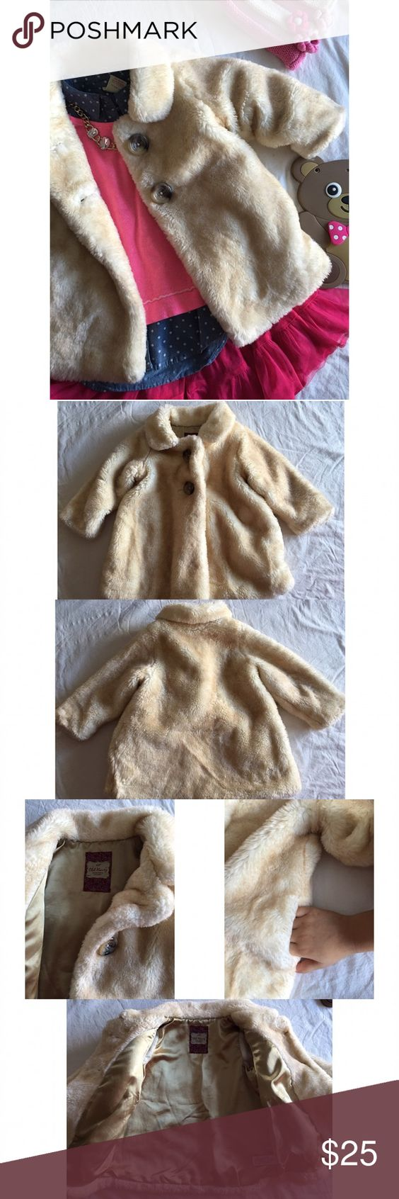 Kids Old Navy faux fur coat Kids Old Navy faux fur coat. Warm and cute. Pockets on the sides. Slightly worn, as shown. No tears, no stains. Size: 2t Old Navy Jackets & Coats
