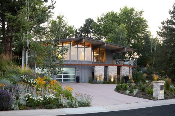 Mid Century Renovation Colorado by Comstock LLC is a great looking project. I really like the exterior of the house mixed with the stunning landscaping.