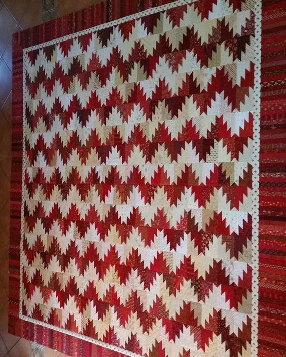 Red and white Scrappy Mountain Majesties flimsy is finished. It's a Bonnie…