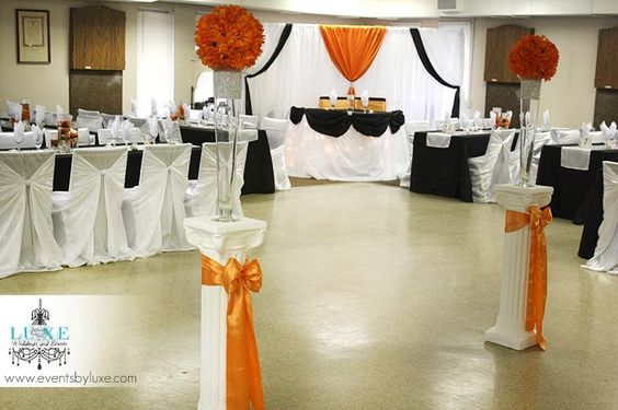 Orange black and white wedding backdrop and head table for Wedding ceremony table decorations