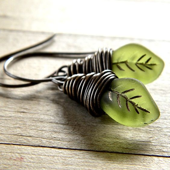 "feeling green... :) ""14 x 9mm frosted Czech pressed glass leaves in a gorgeous olive green with accents of gold securely wrapped with brass wire and antiqued for a rustic, organic look.""- etsy."