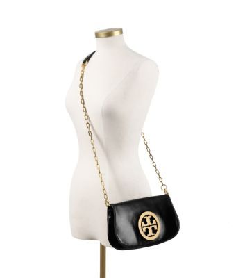 Absolutely LOVE my new Tory purse in Silver!!! Details: Logo Clutch | Womens Clutches & Evening Bags | ToryBurch.com
