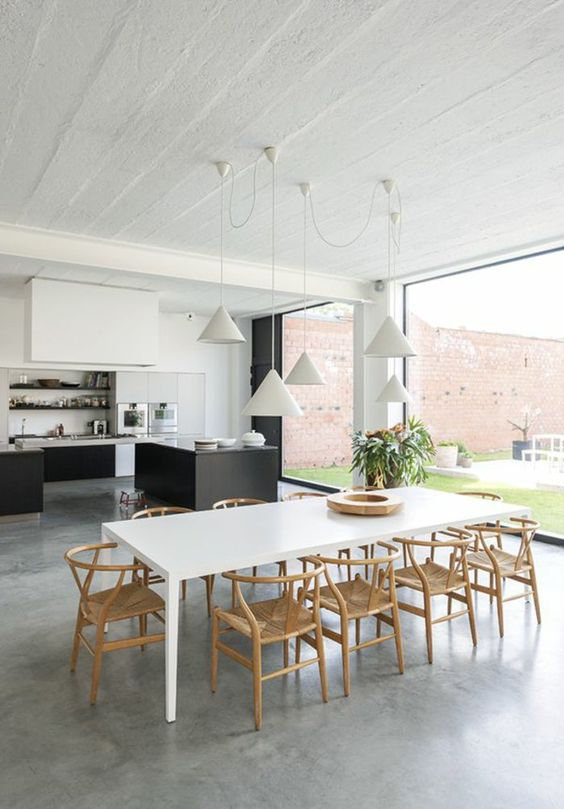 Modèle de cuisine moderne avec un sol en béton ciré