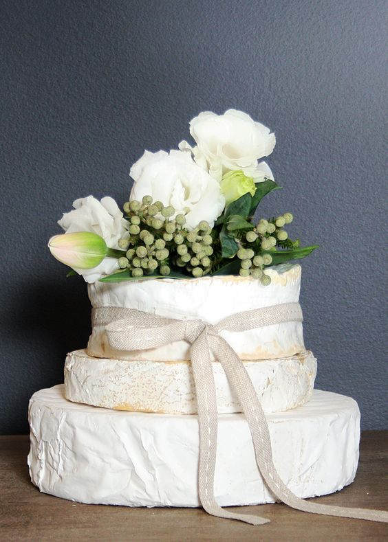 Cheese Wheel Tower for appetizers that looks like a wedding cake.