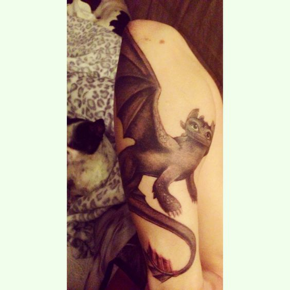 My favorite piece , toothless the dragon my front forearm wraps around the back , he's absolutely adorably perfect :)