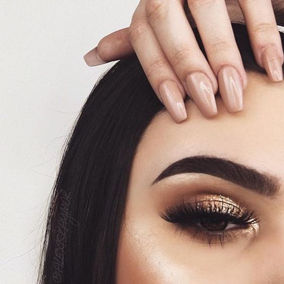 Bronzed and beautiful. Try RMS Eye Polish in solar and layer a deep gold shimmer shadow over: