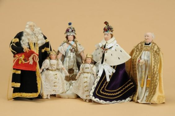 """Set of 10 inch """"Coronation dolls"""" by Liberty of London. Issued in celebration of the crowning of George VI in 1937 (the Stuttering King of the King's Speech movie) the set includes George VI, his wife Elizabeth, and his two daughters Elizabeth (later Queen of England) and Margaret, in addition to the Archbishop of Canterbury and the Lord Chancellor. These dolls were handmade with extreme attention to detail."""