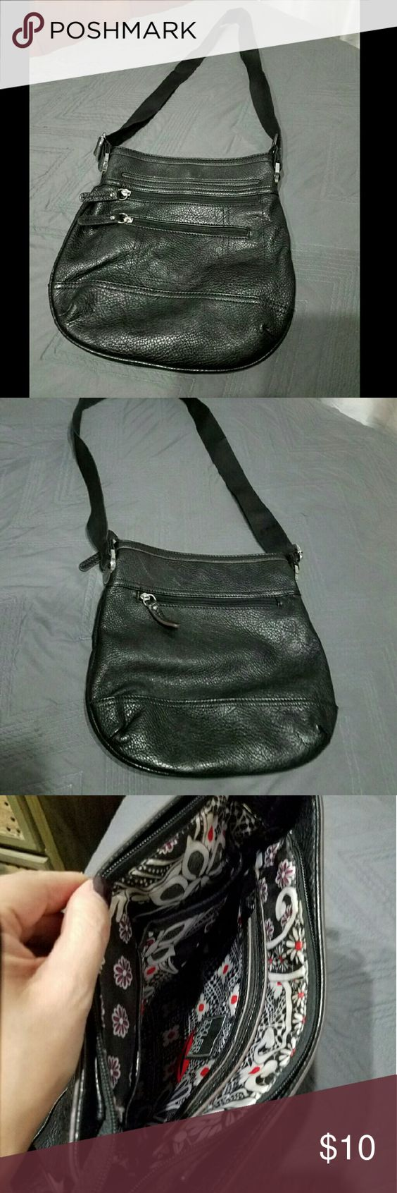 Tyler Rodan Purse Black gently used black purse. The purse has a lot of pockets and an adjustable strap. Dimensions are approx 11L x 10H. Purse has a couple small scuffs but is in otherwise good condition. Bags Shoulder Bags
