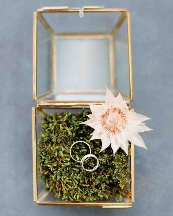 A Bold, Autumnal Wedding in NYC | Martha Stewart Weddings - A brass-trimmed glass box lined with moss held the wedding bands.
