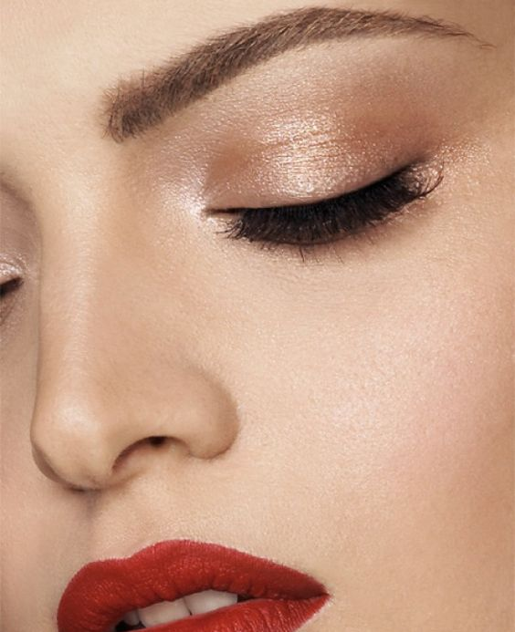Add a pop of red to your look by keeping the eyes a neutral color.