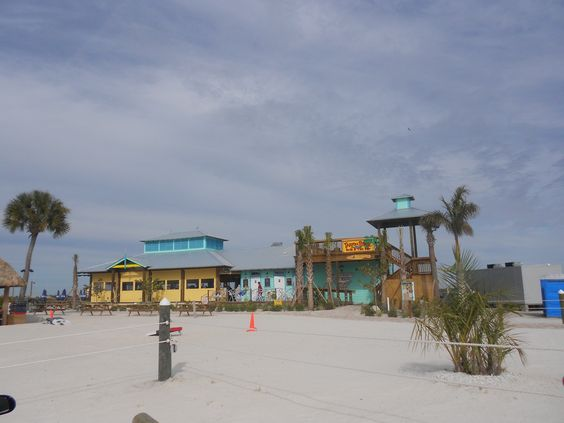 Bradenton, FL - Tarpon Pointe Grill and Tiki Bar - at the Manatee Landings Marina on the Manatee River, the restaurant features a Floribbean menu, live entertainment, flat screen tvs, volleyball, corn hole toss games - they say it's like enjoying a vacation in your own backyard.