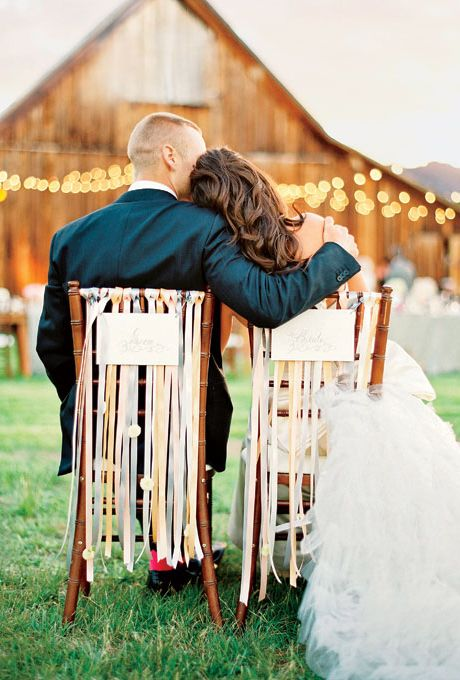 Brides.com: A Glamorous Wedding with Rustic Touches. The seats of honor were decorated with ribbon fringe.