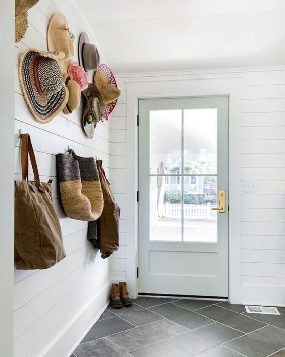Love this entryway/mudroom space with a beautiful door. #door #doorenvy #entryway #mudroom