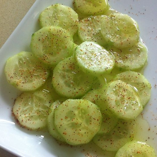 Good snack or side to any meal. Cucumber, lemon juice, olive oil, salt, pepper and chili powder on top