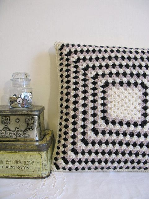 Love the simple colors of this granny square pillow made by Emma Lamb