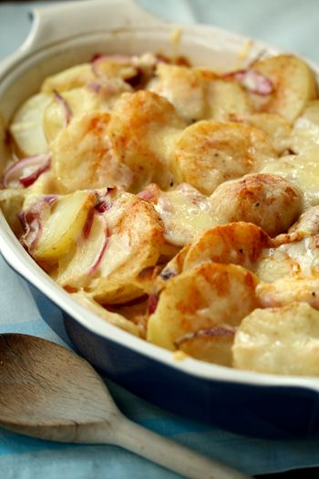 Scalloped potatoes are one of my favorite fall and winter dishes.  Just the smell of them transports me back to my Granny's kitchen where she used to sit constantly slicing or grating something fresh for her home-cooked meals.