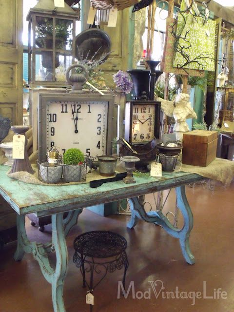 love so much about this picture - especially the clocks & blue distressed table