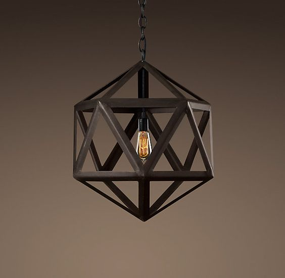 """STEEL POLYHEDRON SMALL PENDANT  $350  Classic triangular forms create the beautiful symmetry of our openwork pendant. Constructed of sturdy steel in an industrial finish with an aged patina.    A metal sleeve, finished to match the frame, covers the porcelain socket  6' black cloth-covered wire  Requires one 60W max. bulb  Hardwired  Wipe with dry, soft cloth  DIMENSIONS  21½"""" diam., 21½""""H  Weight: approx. 9 lbs."""