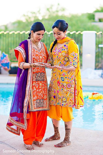 Punjabi weddings | Mehendi Ceremony | Bride Showing Mehendi to her Mother | Poolside Photography | Mom and Bride Picture Ideas | Cute Bride and Mother Photo Ideas | Indian Wedding | Indian Brides | Function Mania | You Have to See These Picture-Perfect Mother & Bride Moments!