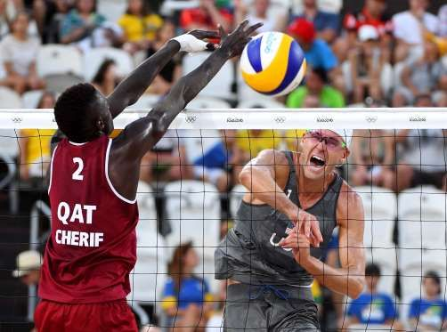 Casey Patterson (USA) hits the ball against Cherif Younousse Samba (QAT) during the men's beach voll... - Jack Gruber-USA TODAY Sports