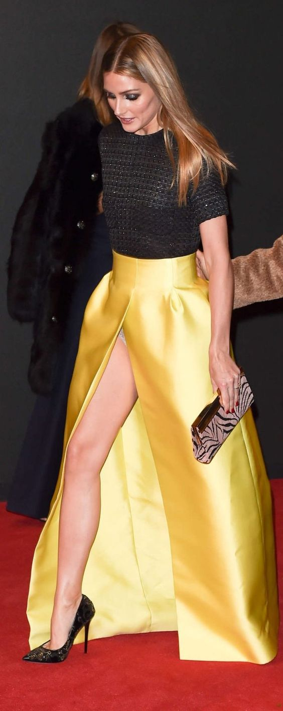Olivia Palmero rocking a Black Sequin top and a Gold High Split Floor Length Maxi Skirt with an animal print clutch purse.