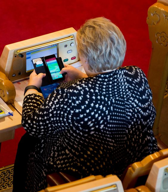 Erna Solberg, the prime minister, playing Pokémon Go in Norway's parliament. Photograph: Tom Henning Bratlie/Klassekampen
