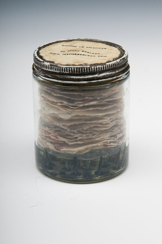 """""""Bottled Up Emotions""""--this is a book in the jar. The site has a ton of ideas, a lot of altered books."""