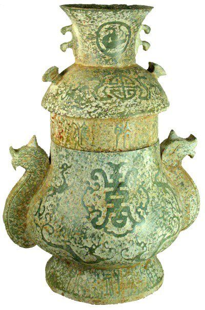 """Jade container with a lid, griffin handles and dragons. Chinese writings on the body and lid. Western Zhou.  500 BC 12 """"× 9"""""""
