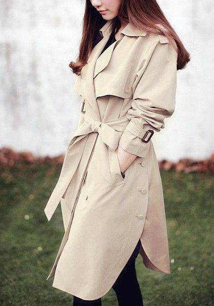 Angled side view of model in khaki side-button trench coat