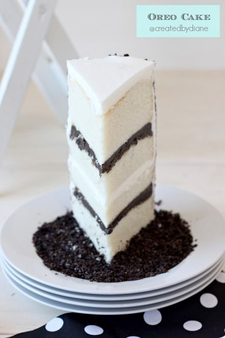 Oreo Cake - White cake with Oreo Filling and Buttercream Frosting - (Sometimes crumbs can be great!)  +-:>=`~