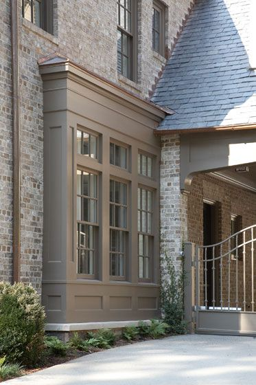 Beautiful updated bay window taupe window frame