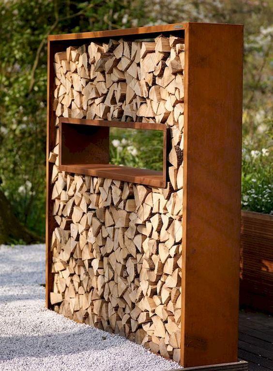 firewood storage with a shelf area in the middle #fireWoodStorage #firewoodrack #firewood #firewoodideas #organization #outdoorFurniture #backyardFurniture #patioFurniture