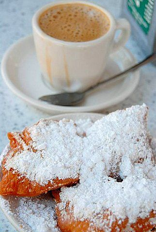 Typical Breakfast with Beignets and coffee at Cafe du Monde,  French Quarter…