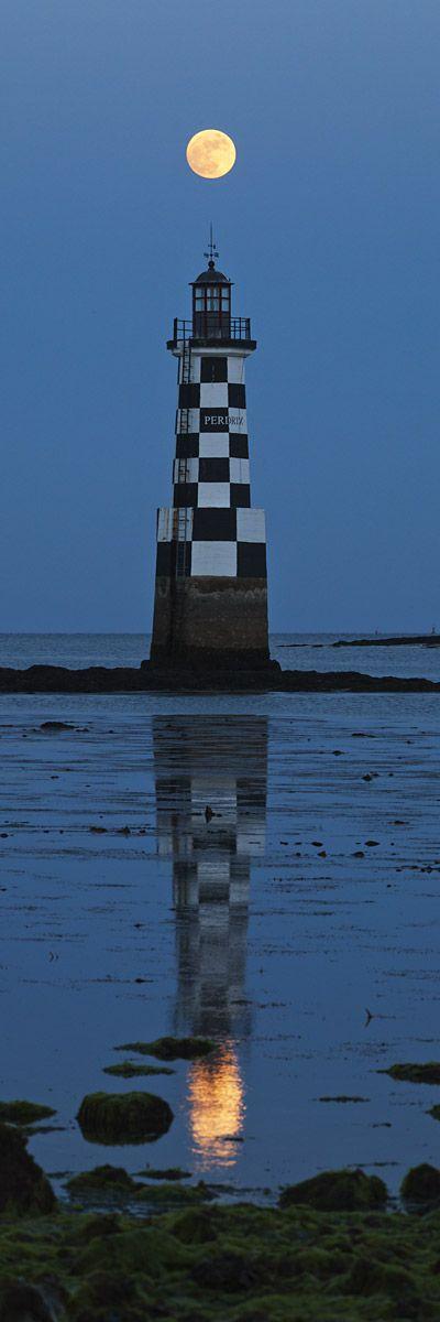 """"""" La lune, comme un point sur un i """" ( Alfred de Musset ) / Phare de la Perdrix checkered black and white. / Pont-l'Abbé. / Brittany, Bretagne. / France."""
