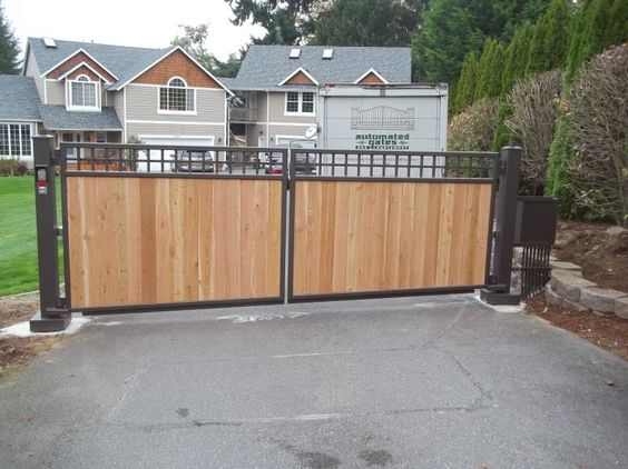 Pinterest the world s catalog of ideas for Double wooden driveway gates