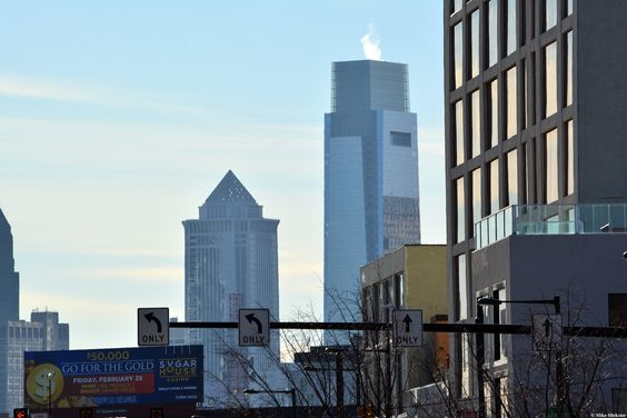 The Mellon Building (left) and the Comcast Center are seen in the background.