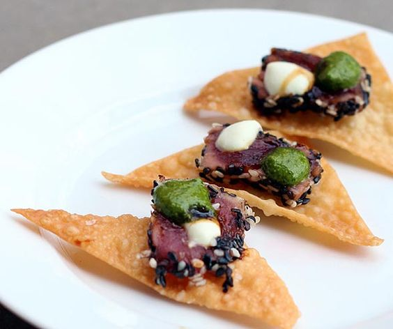 Have a whole meal in a single bite with Sesame Crusted Seared Ahi Tuna on a wonton crisp.