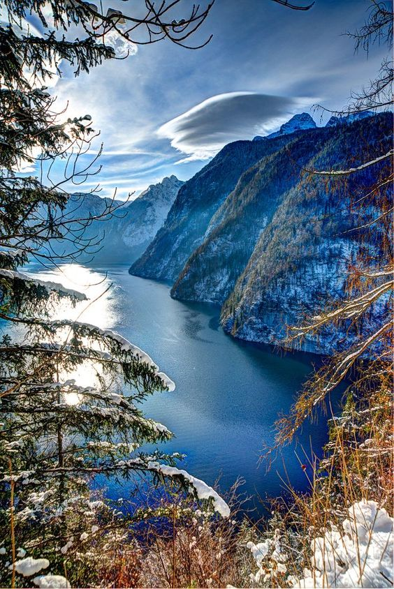 The Königssee in Bavaria, Germany. Most of the lake is within the Berchtesgaden National Park. The Königsee is Germany's third deepest lake. It has become a tradition for boat tours to stop and play a Flugelhorn or trumpet to demonstrate the echo created by the surrounding sheer rock walls.