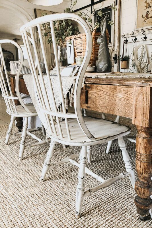 Spring inspiration and decorating ideas! Modern white Windsor chairs at a vintage wood table decorated for Spring.