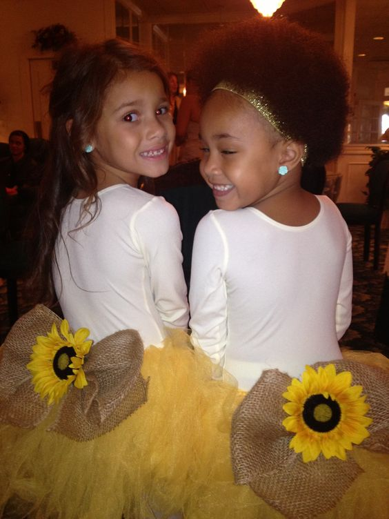 Sunflower wedding flower girls, would be such a fun creative way to save money, and not wreck an expensive dress for the girls! @Michelle Flynn Elliott-Cook @Jenn L DeFoy