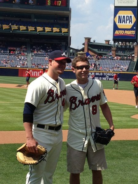 Scotty McCreery threw a few pitches off the mound to Craig Kimbrel who gave Scotty his very own Braves jersey.