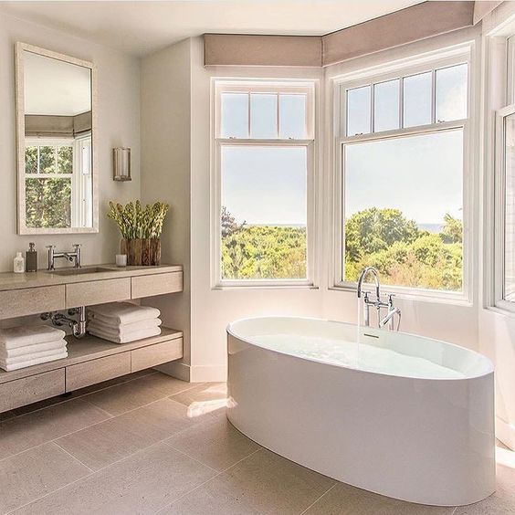 This #bathroom has a nice #clean feel to it with a great #view as well.  #bath #bathtub #bathrooms #home #house #hgtv #diy #homediy #interior #inspiration #interiordesign #realty #realtor #realestate #tile #glass #window #windows #neutral #color #colors by chris_estates