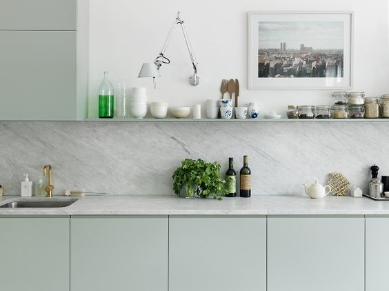 Emma Persson Lagerberg's beautiful mint green kitchen. Photo by Petra Bindel for Elle Interiör, via Remodelista.