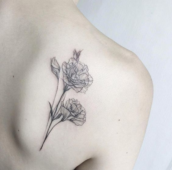 Delicate black and grey ink floral tattoo on back shoulder by Tattooist Flower