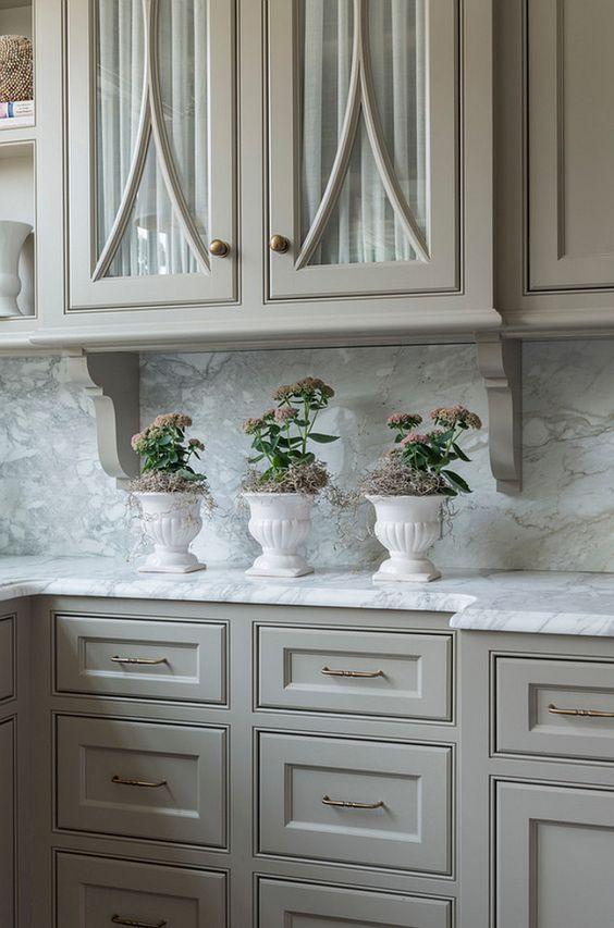 "Kitchen cabinet paint color is ""Revere Pewter Benjamin Moore HC-172"". Taste Design Inc."